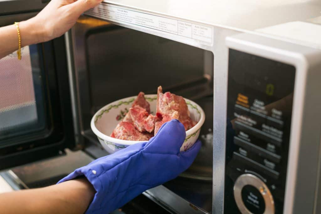 Safely defrost meat in the microwave.
