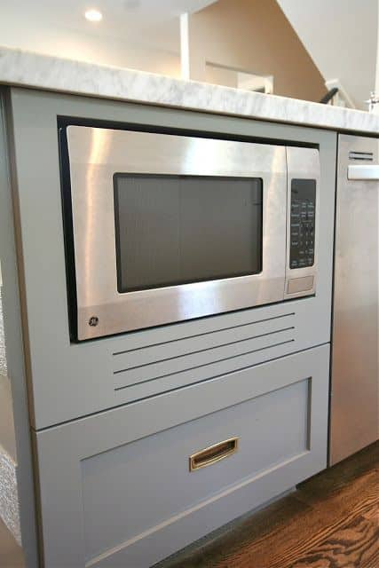A built-in convection microwave installed in a cabinet.