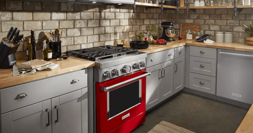 A colorful oven adds a pop of color to a minimalist kitchen.