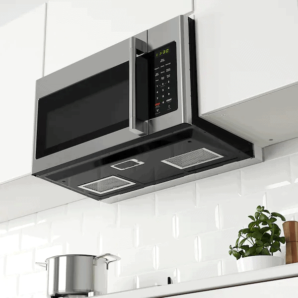 An over-the-range microwave installed in a kitchen with minimalistic décor.